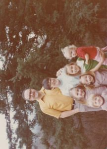 My Daddy. Tall like the trees behind him. I am the girl standing closest to him.